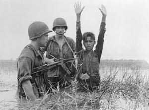 Troubled times: French paratroopers capture a guerilla of the Communist Viet Minh forces in a swamp during the Vietnam War. Photo: Getty Images