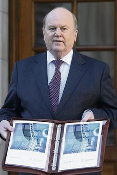 Finance Minister Michael Noonan presenting Budget 2013 last year