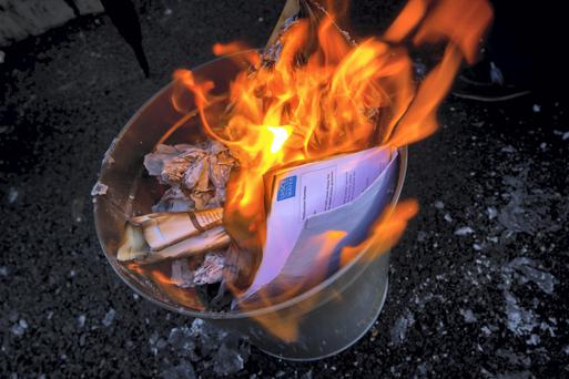 Irish Water application packs being burned at a protest: are citizens' interests being torched for financial considerations?