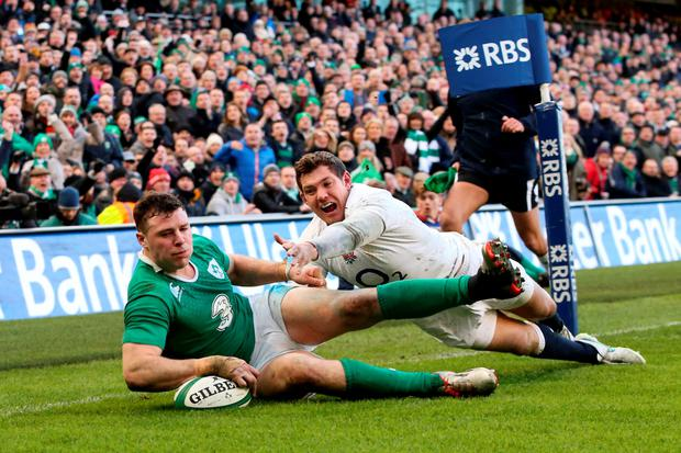 Robbie Henshaw scores a try against England