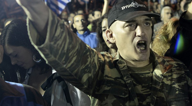 A supporter of neo-fascist party Golden Dawn at a march in Athens