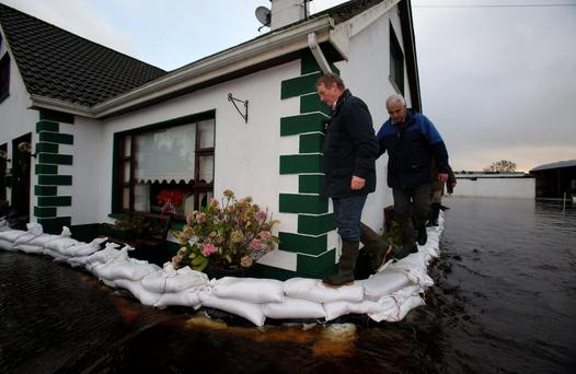 Enda Kenny visits a flooded household in Carrickobrien, Co Westmeath. Photo: PA