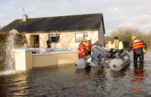 Civil Defence members arrive at Patrick Mason's flooded home in Clonlara, Co Limerick, in December 2015