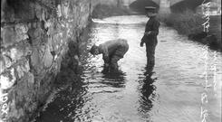 British soldiers search the Tolka river for firearms in the aftermath of the 1916 Rising.