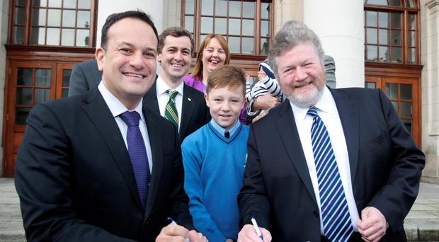 Former ministers for Health and Children, Leo Varadkar and James Reilly, sign the order banning smoking in cars with children, in December 2015 Picture: Tom Burke