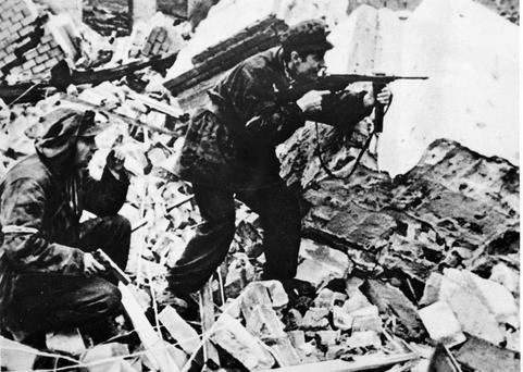 Polish partisans fire on German troops in 1944, during the brutal Nazi occupation of Poland. Photo: Getty