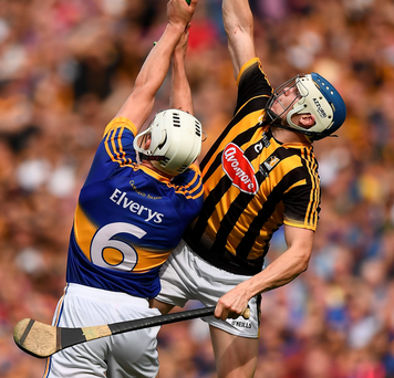 TJ Reid of Kilkenny and Ronan Maher of Tipperary battle for possession in the GAA Hurling All-Ireland Final. Photo: Brendan Moran/Sportsfile