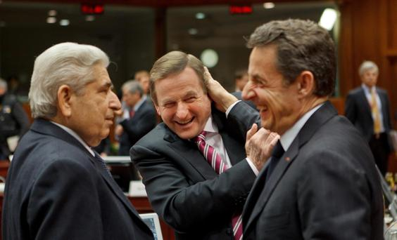 Patronising: Nicolas Sarkozy (right) and Taoiseach Enda Kenny in 2012