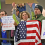People protest against US President Donald Trump's travel ban at Indianapolis International Airport, Indiana Photo: Kelly Wilkinson/AP