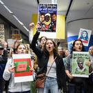 Demonstrators protest against the travel ban, at San Francisco airport. Photo: Kate Munsch