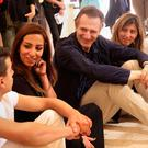 Actor and Unicef ambassador Liam Neeson (centre) talks to Syrian refugees in Jordan on a vist there last year. Photo: Sam McNeil/AP