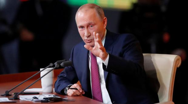 Eye for an opportunity: Vladimir Putin. Photo: Reuters