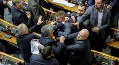 Bad example: This fistfight between politicians in the Ukrainian parliament in Kiev last week is emblematic of the falling respect for democracy. Photo: REUTERS