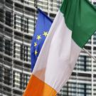 TIES: An Irish tricolour flies next to an EU flag near the EU Commission headquarters in Brussels. Photo: Reuters