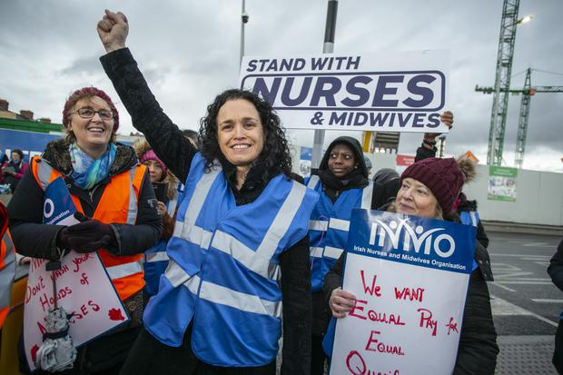 Support: Phil Ní Sheaghdha, general secretary of the INMO, with nurses at St James's Hospital. Photo: Kyran O'Brien