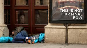 A homeless man takes shelter in the doorway of the Gaiety Theatre. Photo: Gerry Mooney