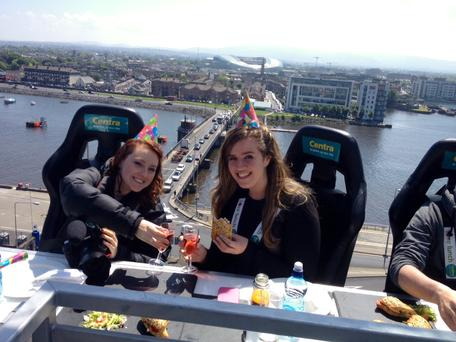 Independent.ie's Clare Cullen (left) and Patricia Murphy (right) sample the new Centra sandwiches 100 feet above Dublin City Center at the #CentraSkyPicnic.