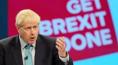 Boris Johnson addressing the Conservative Party conference in Manchester (Danny Lawaon/PA)