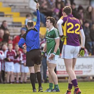 8 March 2015; Referee Michale Collins, shows the black card to Cian Sheehan, Limerick. Allianz Football League, Division 3, Round 4, Wexford v Limerick, Wexford Park, Wexford. Picture credit: David Maher / SPORTSFILE