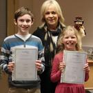 David Mullooly, Ellie-Rose Turner and their teacher Patricia Duffy, director, Dundalk school of music
