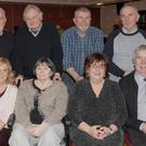 Mary McElroy (second right, front row), with Tony, Joe, Peter, Pat, Hilda, Anne and Gene Kirk at Mary's 60th birthday party in The Lisdoo