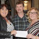 Eamon Murphy, Chairman, Dundalk & District GPA presents a cheque to Kate Devlin McGirr and Phyllis McArdle, Friends of St. Oliver's Hospital at the Dundalk & District GPA Game and Meat Feast night held in Byrne's Pub, Hill Street