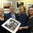 Joe Tully, his wife Kirsi, Anu Vikevainen, chairperson of the Finnish Society of Ireland, and Merja O'Connor, treasurer of the Finnish Society of Ireland, at Joe's exhibition in Arklow Library