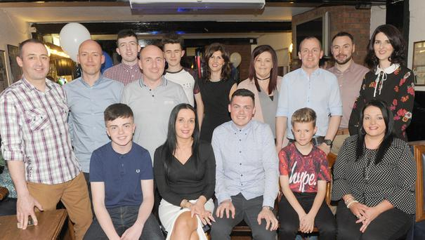 Ciaran Caldwell (centre, front row), with a group of family members, celebrating Ciaran's 21st birthday party in Oriel Park