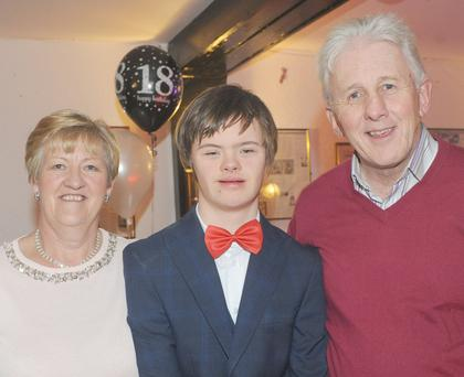 David O'Hare, with Frances and Dermot McClean at David's 18th birthday celebrations in Oriel Park.