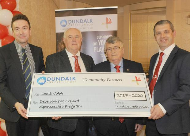 Billy Doyle and Frankie Watters, Dundalk Credit Union make a presentation to Paddy McMahon and Des Halpenny, Louth County Board at the Louth GAA presentation night in The Four Seasons Hotel, Carlingford.
