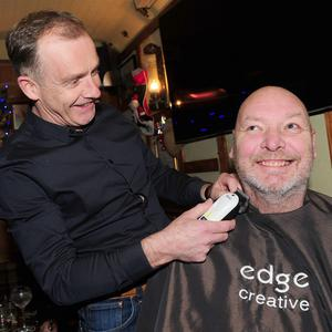 Gerry Hoey gets ready to shave Barry O'Hanrahan