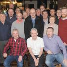 Niall McGuinness (centre, front row), with An Post work colleagues at the retirement function for Niall held in Oriel Park