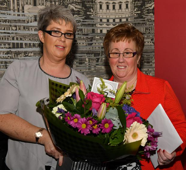 Olive Lynch makes a presentation to Barbara Collins