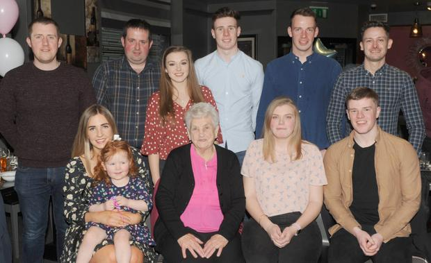 Nancy Neary celebrating her 84th birthday party in The Lisdoo with her great grandchild, Katie Traynor, along with grandchildren, Lisa, Conor, Mark, Eamonn, Laura, Rebecca and Robert Neary along with Niall and Ciaran Traynor