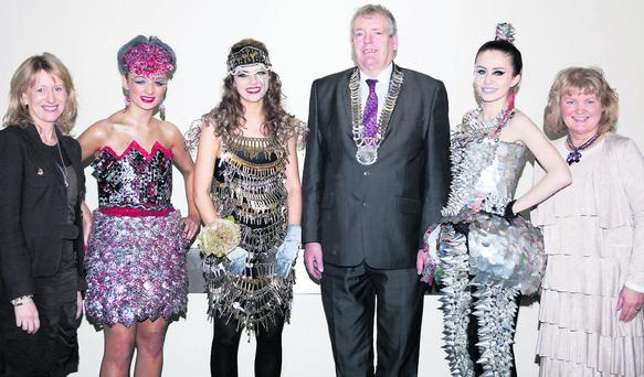 Top, local Junk Kouture entrants with members of Louth County Council, Aisling Sheridan, Louth Co Council, 'Cantastic', Mary Rose McCarragher, Bush Post Primary, 'Unlocked', Maebh O'Hanrahan, St. Vincent's Secondary School, Chairman, Louth County Council, Cllr. Finnan McCoy, 'Straight to the Point', Orla Murray, St. Vincents Secondary School, Mary Murtagh, Louth County Council. Right, Maebh O'Hanrahan.