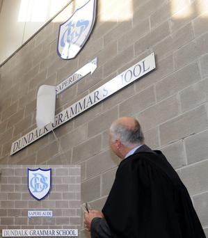 Principal of Dundalk Grammar School, Cyril Drury, unveils the new school motto 'Sapere Aude' or 'Dare to Know'.