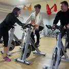 "Kelly Mulholland from ""Spinning With Kelly"" studio at Stephenstown Pond with Stella Mallogocce from Castlebellingham and Professional Golfer Joe Frawley during a workout session before Pancake Day at the Pond"