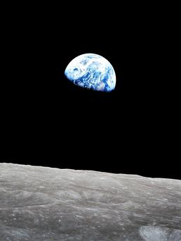 Earthrise from the surface of the Moon as seen during the Apollo mission