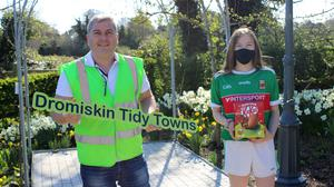 Emily O'Reilly receives her award from Liam Reilly, Dromiskin Tidy Towns as a result of her participation in the event for National Tree Week 2021 held in Dromiskin