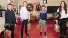 Eoin McCoy, Elliott Nichlos, Liam Keenan and Niamh Carolan at the 6th class graduation ceremony in Rampart National School. Photo: Aidan Dullaghan