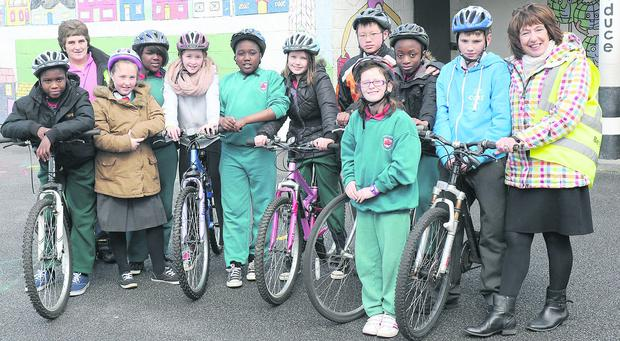 Mary Kelly of 'Pedal Right', Principal Mary Hession, and Fifth and Sixth Class pupils who took part in the Go Dundalk Smarter Travel Cycle Training at Realt na Mara NS