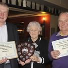 Pat Flanagan of Flanagan Motors (Sponsor), presents the 1st prize in the Best Hanging Baskets/Window Boxes to Kathleen Lynch (For Kay Lynch) and the 3rd prize in the Best Small Garden Category to Donal Lynch during the Beautiful Blackrock Awards 2015 night held in The Clermount Arms