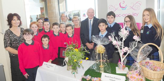 Judges, John Fitzgerald, Eileen Collery and Tom Hayes, with Teachers, Florence Gillan and Paula Quigley, along with pupils of St. Oliver NS and Bush Post Primary School during the judging of the Enterprising Towns Awards Competition in Carlingford