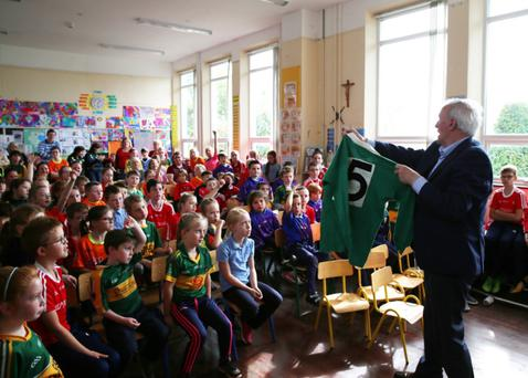 Frank Lynch showing the pupils of Muchgrange School the Leinster jersey he wore in the All Ireland Final in 1957