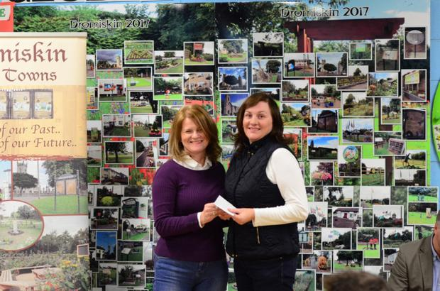 Marina Lowry, 11 Seabrook Dromiskin receives an award for Permanent Style Planting Garden from Brenda McGeeney Dromiskin Tidy Towns