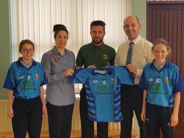 Bellurgan National School would like to thank Fitzpatrick's Restaurant for their generous sponsorship of new school Jerseys. The Girls GAA Team recently wore the Jerseys for the first time as they lifted the Corn Shean MacCaba for the first time in our schools' history. Pictured (Left to Right) Niamh Holland (Vice Captain), Miss Majella Murray (Girls' Coach), Ronan Fitzpatrick, Dermot McCoy (Principal) & Sophie Hanlon (Captain)