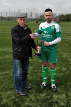 Mick O'Reilly, Chairman of the North Louth Winter League, presents the League trophy to Declan McGuinness, captain of Carlingford Celtic
