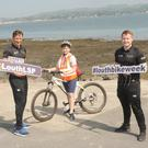 Paul Casey and Paul Mackin, Louth County Council, with Ben O'Hare, Monksland National School who was one of a large group of pupils who cycled the Carlingford-Omeath Greenway as part of the Greenschools Project