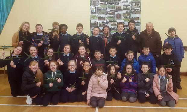 6th class pupils with some of 3rd with their class teacher, Ms Aisling Fahy and the crafts people, Kete Holland, Jacinta Kelly and Michael Kelly from Kilkerley National School during the making of St. Brigid's Crosses in the School