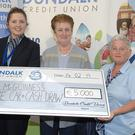 Anne McGuinness from Lower Faughart winner of€5000 in the Dundalk Credit Union Cash draw receiving her cheque from Megan Hughes and Pauline Crosby of Dundalk Credit Union